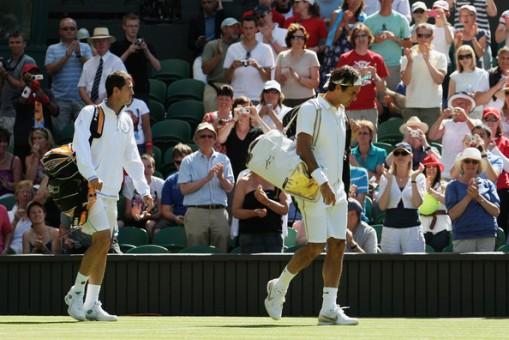 Guillermo Garcia-Lopez y Roger Federer